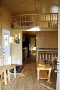 Lake Rudolph Campground and RV Resort Christmas Cabins in Santa Claus, Indiana Looking into the Kitchen and Loft Area