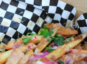 The Poutine de Peru Fries are tossed in a Peruvian yellow pepper suace.