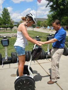 White River State Park Director Bob Whitt gives a Segway lesson to Emily Roark