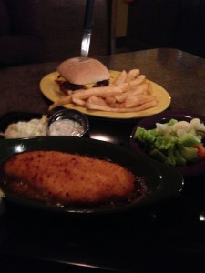 My Cappo's baked cod and my wife's burger and fries, piping hot and delicious.